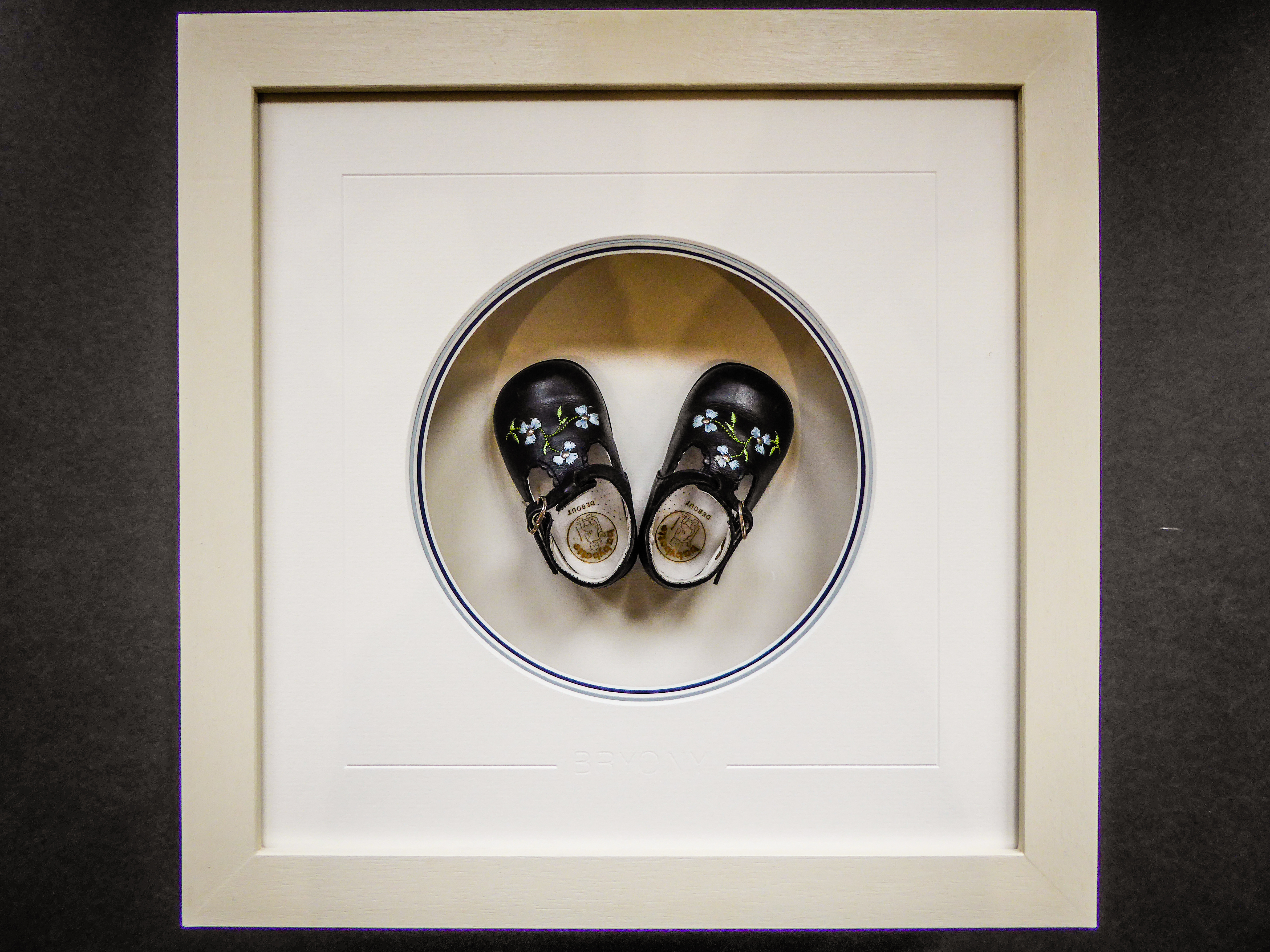 Children's first shoes framed by Jules Sainter
