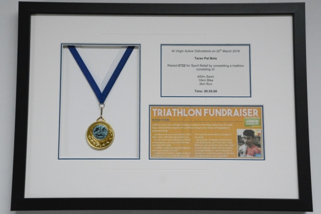 Fundraising medal and newspaper clipping | (lovingly framed by Jules Sainter (lovinglyframed.co.uk)